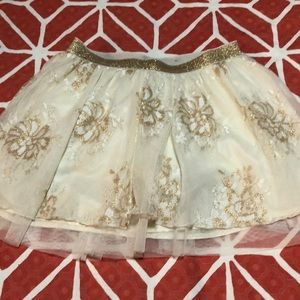 A white flower skirt with sparkles